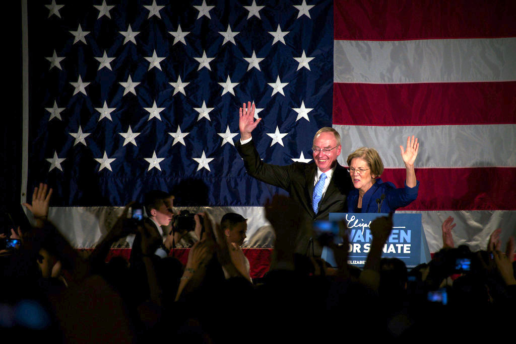 Elizabeth Warren and her husband, Bruce Warren, wave to supporters after her victory speech Tuesday night. (Photo by Cat Ring/BU News Service)