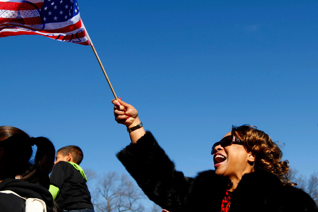 Image: A Barack Obama supporter reacts ion the National Mall as she watches a telecast of the swearing-in on Sunday. (Photo by Billie Weiss/BU News Service)