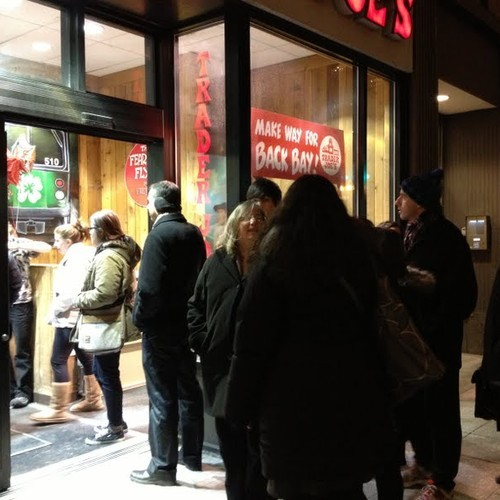 Image: Shoppers like up outside Trader Joe's in Kenmore-Fenway prior to the arrival of storm Nemo Thursday night. (Photo by Taylor Walker/BU News Service)
