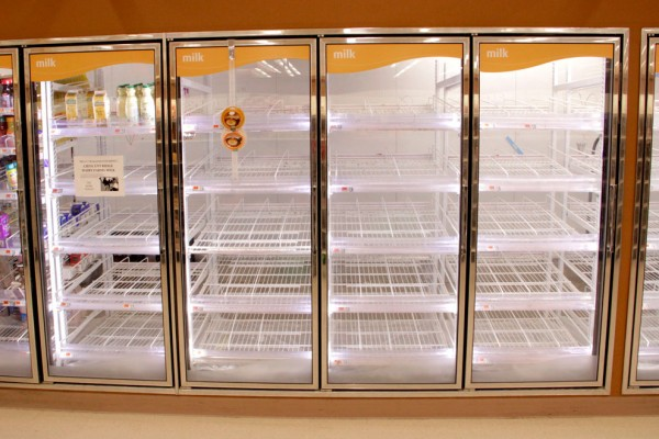 Image: Shelves were stripped of milk and orange juice at Shaw's Supermarket on Commonwealth Avenue at Packard's Corner on Friday as winter storm Nemo heads toward Boston. Approximately two feet of snow is forecast for the greater Boston area. (Photo by Billie Weiss/BU News Service)