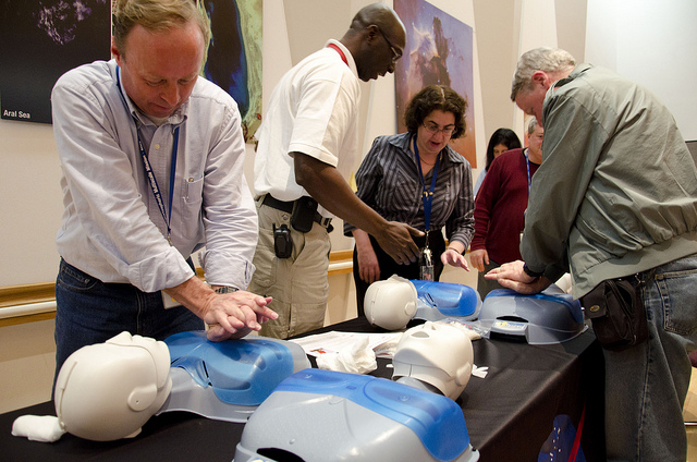 Goddard employees practice CPR techniques March 18, 2011. Photo Courtesy of NASA/GSFC/Rebecca Roth via Flickr Creative Commons.