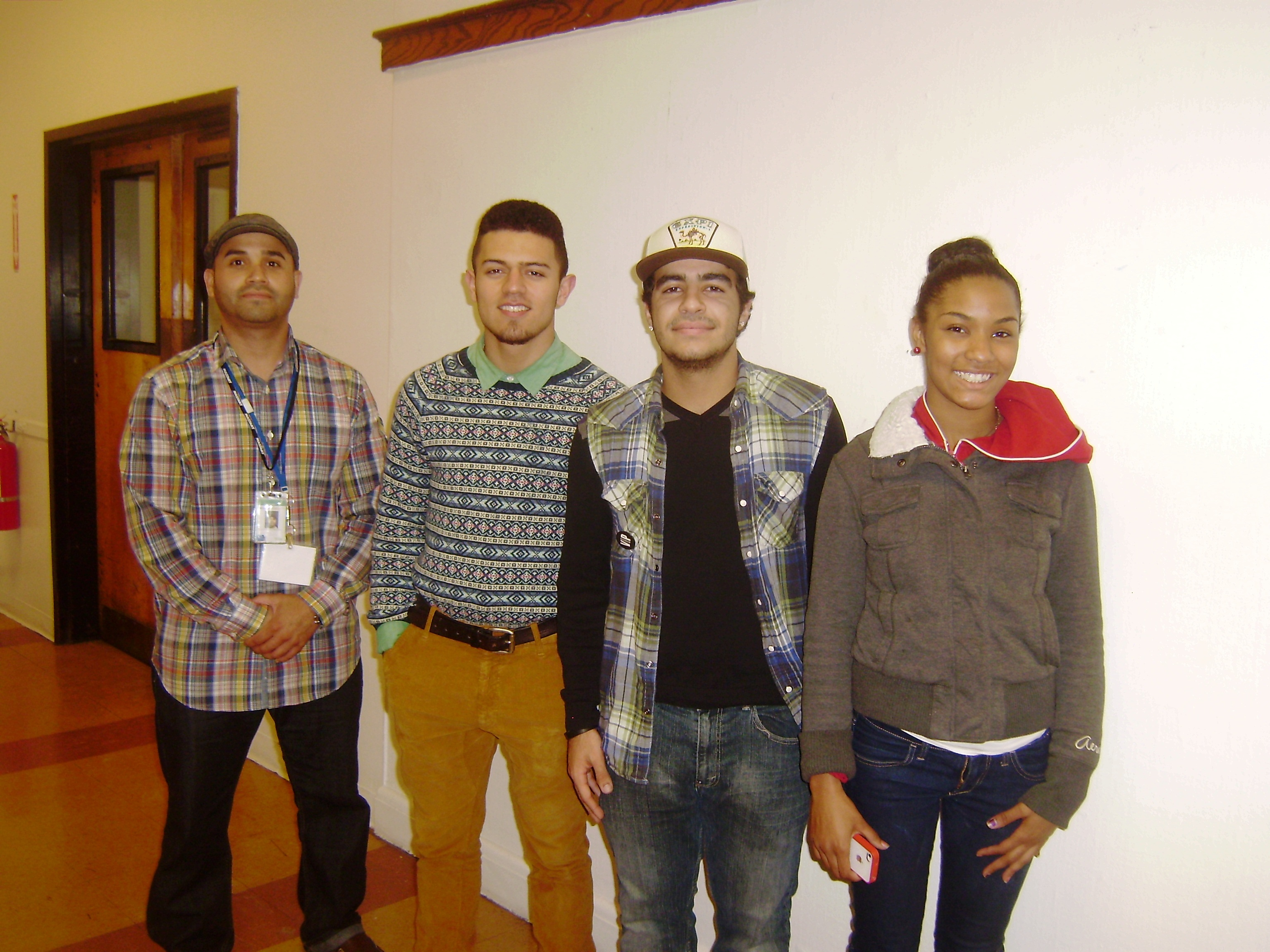 Image: Martin Figueroa, Jeison Peguero, David Landing-leal and Shanique Mitchell participate in a Sociedad Latinas community outreach event in January 2012. (Photo: Jenni Walen)