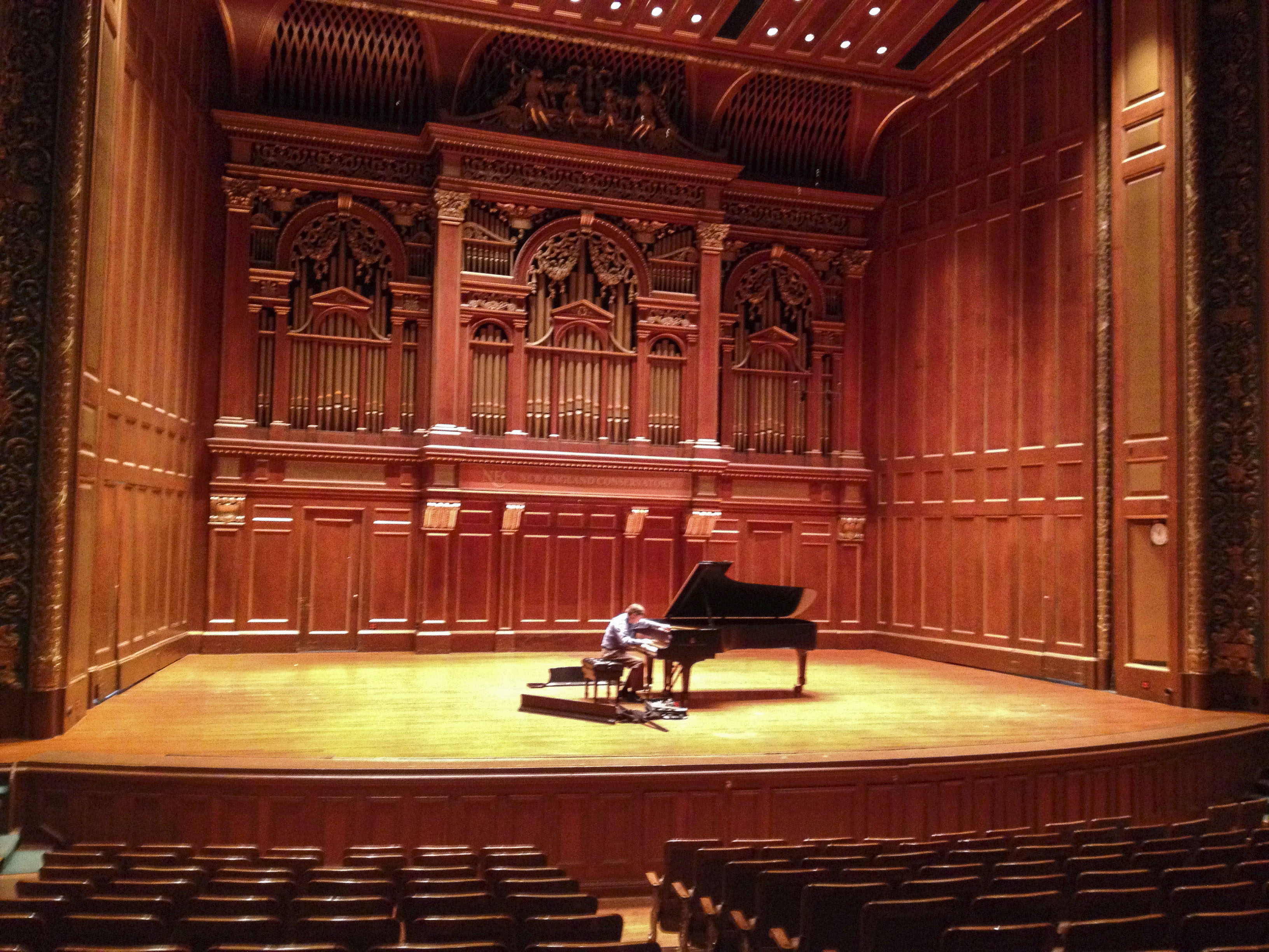 March 29, 2013 -- A piano tuner adjusts the piano at Jordan Hall at the New England Conservatory in preparation for a concert that evening. Photo by Poncie Rutsch.