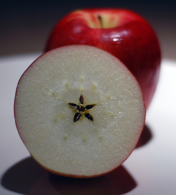 When sliced across the equator, the seeds at the center of an apple forms a pentagram. Photo courtesy of flickr Creative Commons User Denise Cross.