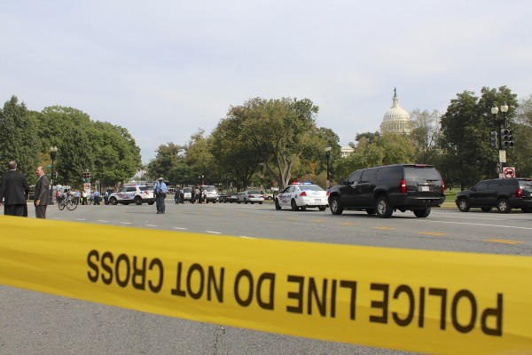 Police tape blocks the intersection of Louisiana Ave. and 1st following reports of a vehicular incident and shots fired near the Hart Senate Building on Oct. 3, 2013.