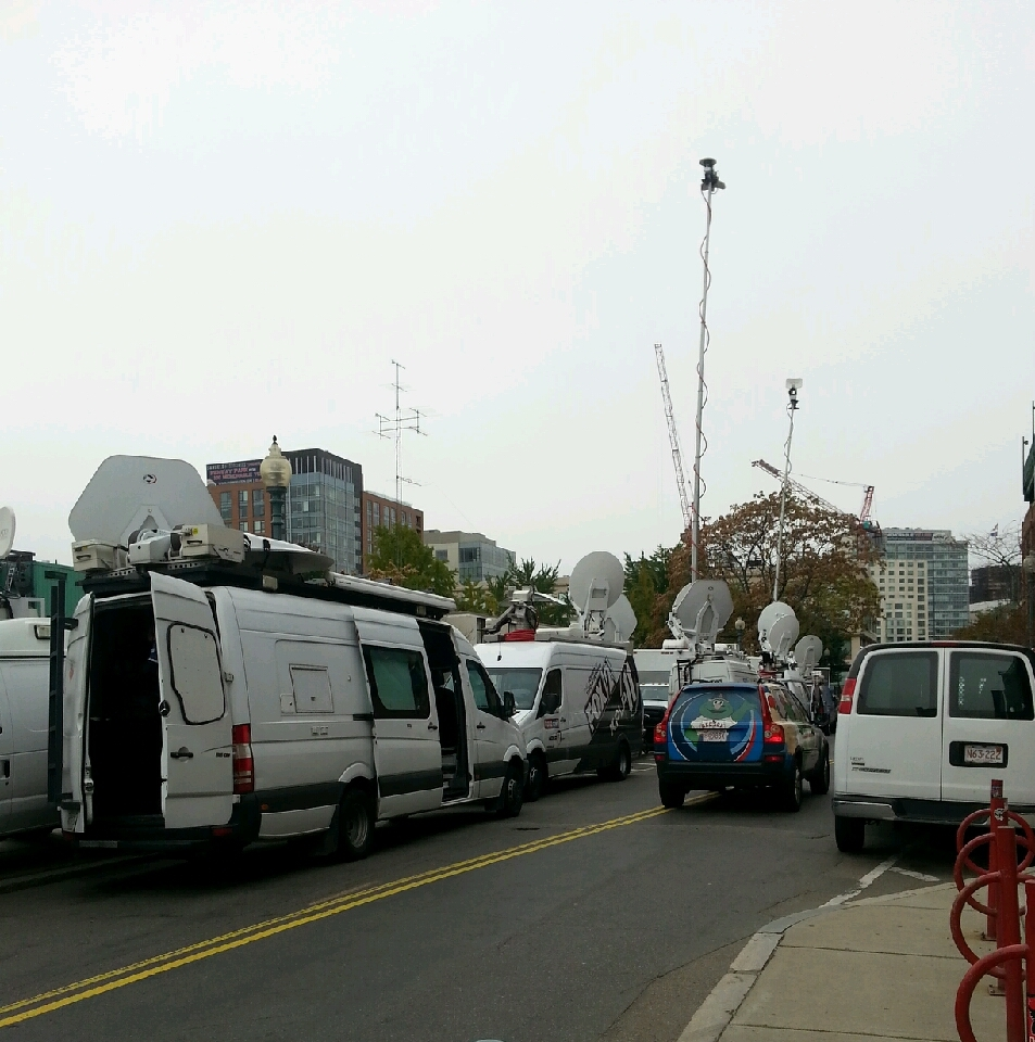 News trucks crowd street near Fenway Park. (BU News Service/Paula Garcia)