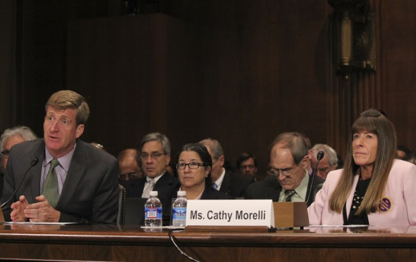 IMAGE: (Photo: Taylor Hartz) Former Rhode Island Rep. Patrick Kennedy speaks beside Southington, Conn. resident and mental health insurance advocate Cathy Morelli, during a Judiciary Sub-Committee hearing on the cost of regulatory delays in mental health care, chaired by Sen. Richard Blumenthal, D-Conn.