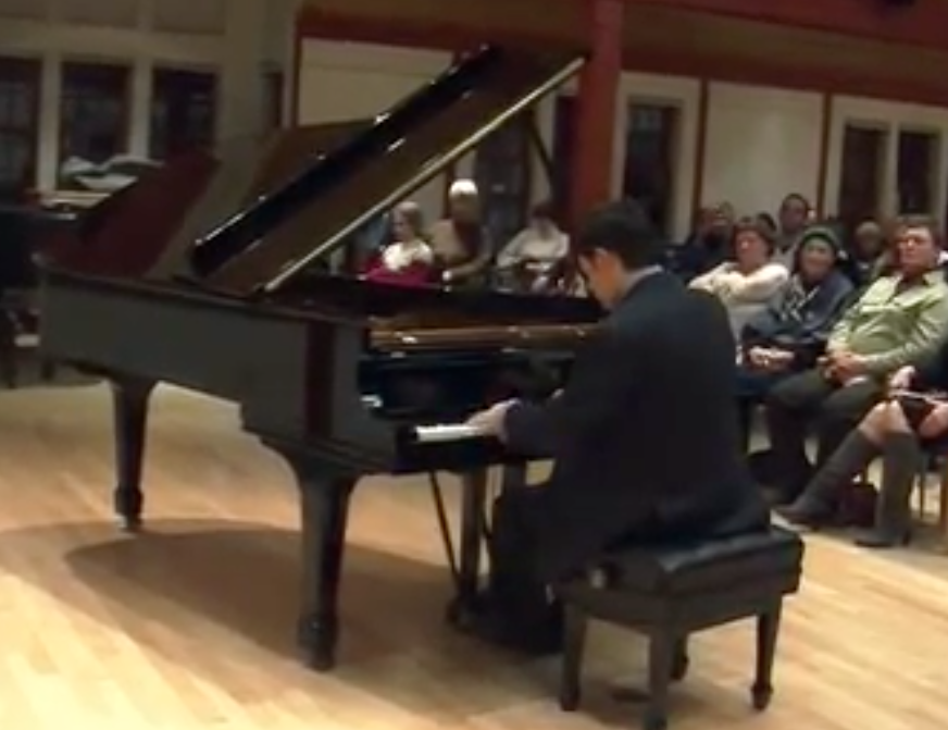Michael Lewin playing Steinway piano at the Scandinavian Cultural Center in Newton
