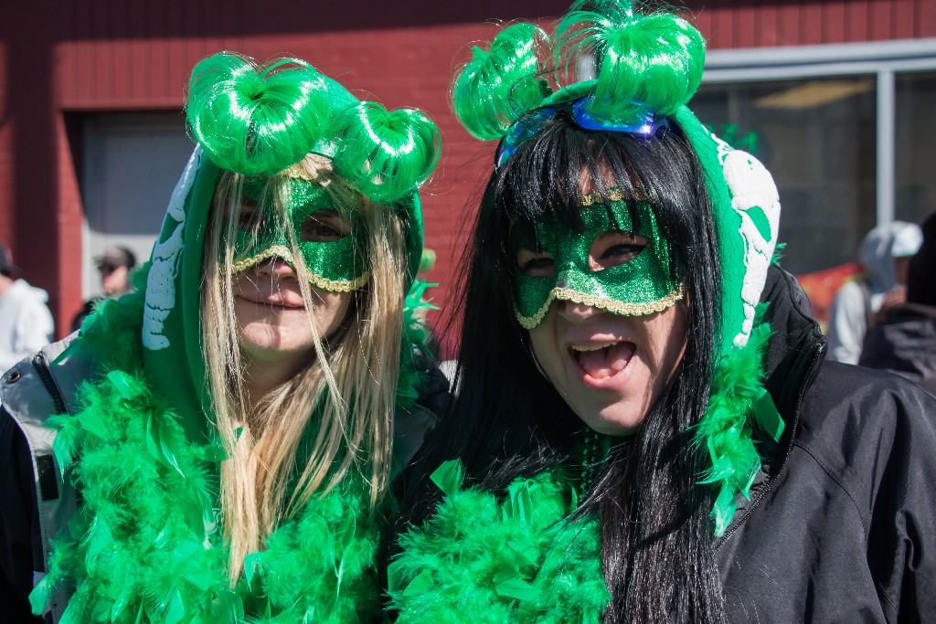 Boston, March 16, 2014 -- Danielle Guillette, right, and Karen Nardone, left, celebrate  near Andrew Station at the St. Patrick's Day parade in South Boston. Photograph by (Carolyn Bick/BU News Service)