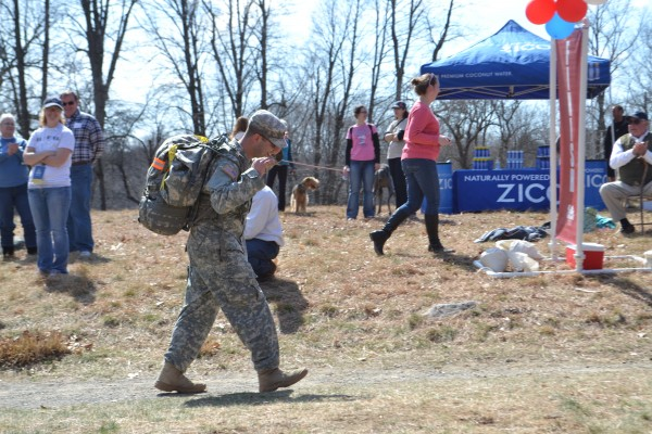 Steve Fiola raises his arms in the air as he finishes his ruck.