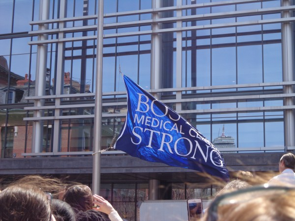 Flag rises during ceremony at Boston Medical Center. (Saba Aziz/BU News Service)