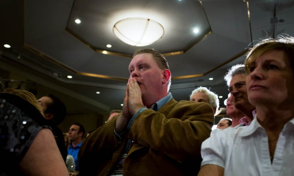 Brock Cordeiro reacts to  election updates at the Seaport Hotel. (E.S. Ro/BU News Service)