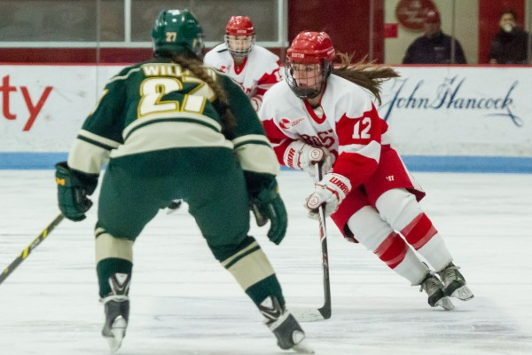 Boston, Mass, U.S. Feb. 27, 2015. Boston University's Victoria Bach, right, in action during the third period of a Women's Hockey East playoffs quarterfinal game against the University of Vermont at Walter Brown Arena. BU won 8-1. (Photo by: Jun Tsuboike/BU News Service)