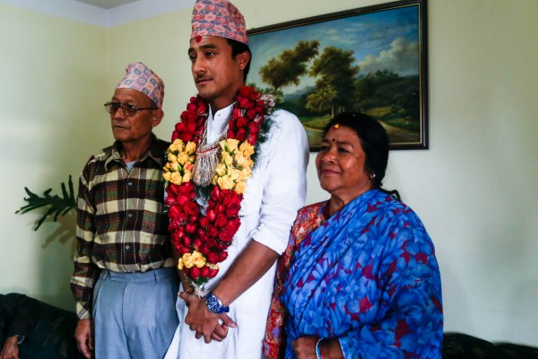 My grandfather, Prem Bahadur Khadka, and my grandmother, Saraswati Devi, with my brother, Paras, during one of the pre-wedding ceremonies earlier this year in March.