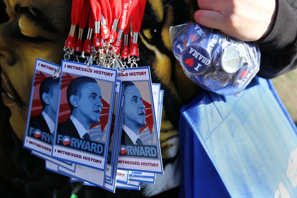 IMAGE: A vendor hawks unofficial inauguration memorabilia in Washington, D.C on the eve of the ceremony. (Photo by Michael Cummo/BU News Service)